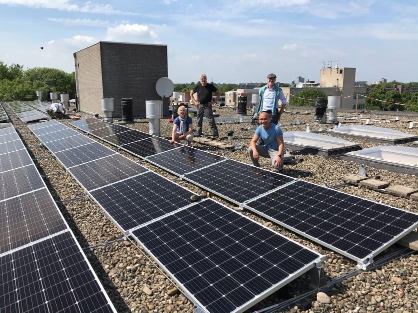 Initiatiefnemers op het dak